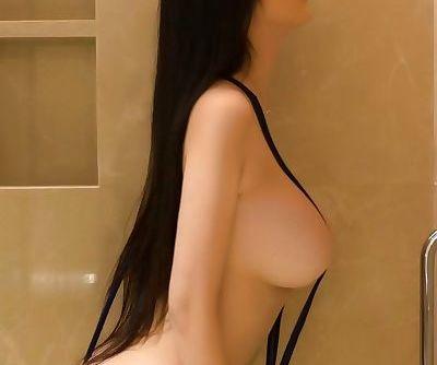 Black sling bikini arched forward