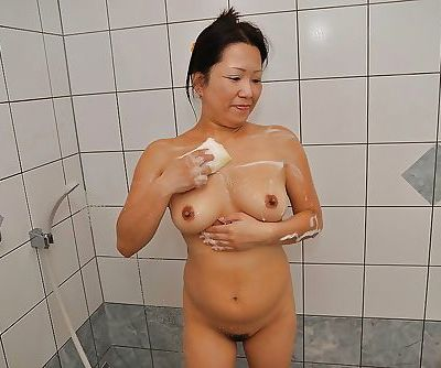 Asian MILF with shaggy cooter and..