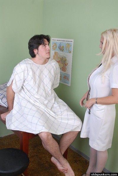 Buxom older nurse Kayla Kupcakes attacks younger man with massive tits