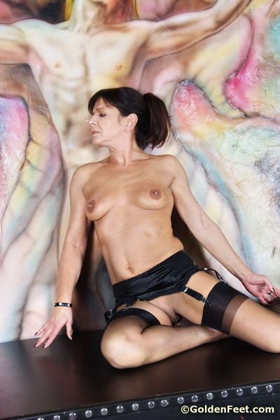 Saucy mature British broad Lady Sarah on cross in nylons and garters - part 2