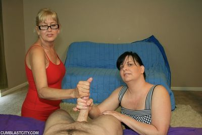 Mature blonde in glasses shares a cock with her friend and gets bukkaked