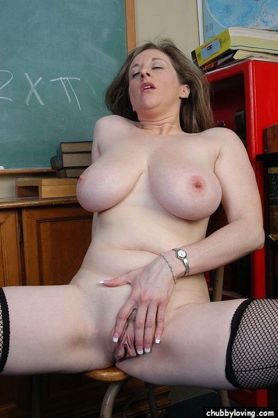 Mature woman Kitty pulls red blouse down and undresses in classroom - part 2