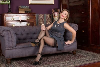 Blonde lady Huntingdon Smyth poses fully clothed in stockings and heels