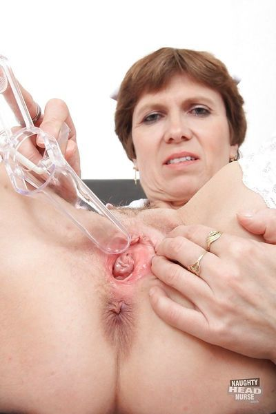 Perverted mistress Oslava is stretching her unshaved pussy with this toy - part 2