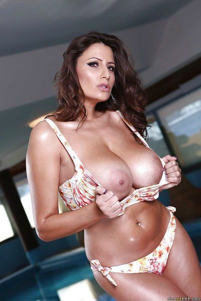 Oiled milf Sensual Jane is posing in sexy bikini at her pool