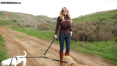 Milf amateur Kelly Madison is having a nice walk with her dogs