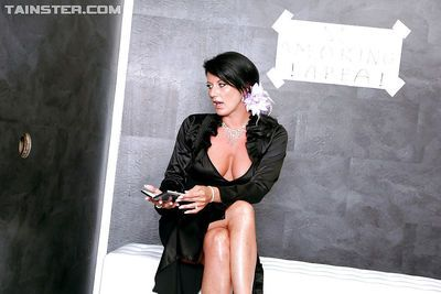 Glamorous MILF performs messy gloryhole scene with a fake cock and jizz