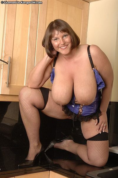 Mature BBW removes latex lingerie to flaunt giant boobs in mesh stockings