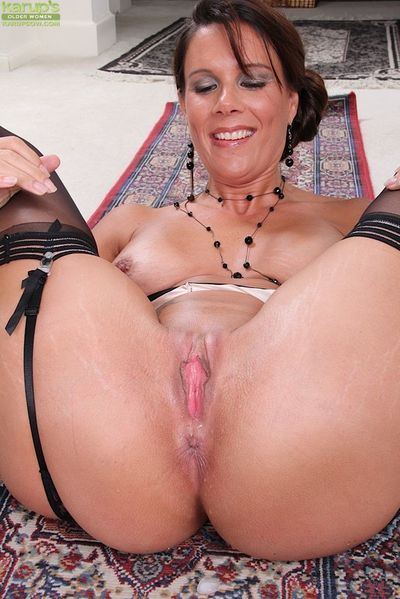 Mature lady Dylan Dole firstly removes glasses before stripping to stockings