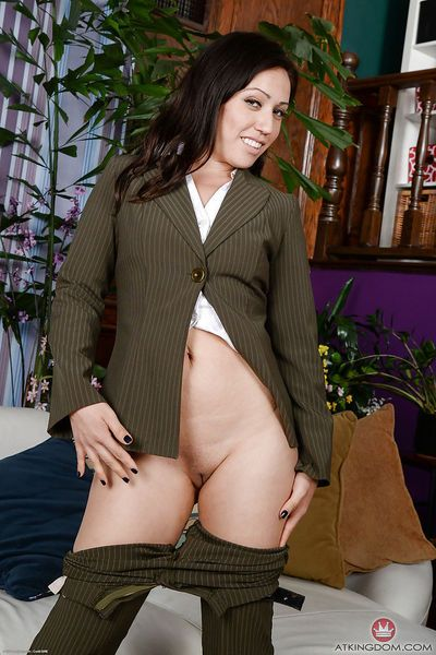 Older brunette Lisa Smith exposing clit underneath business suit in office