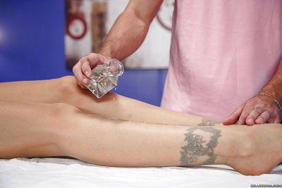 Older pornstar Julia Ann receiving hot oil massage before banging dick