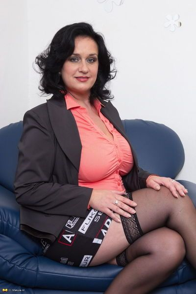 Mature woman flashing white upskirt underwear wearing black stockings