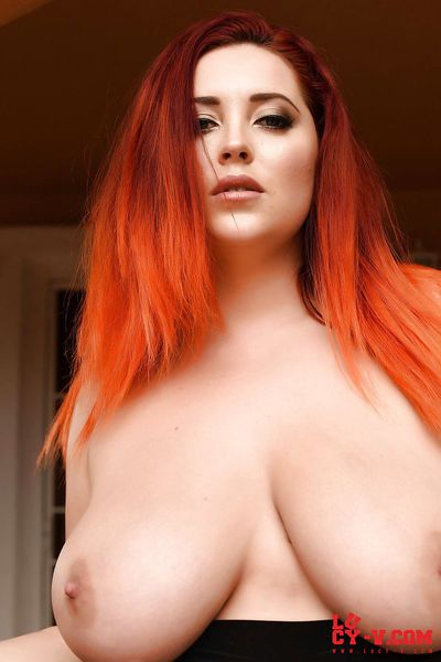 Plump mature redhead Lucy Vixen flashes naked upskirt & bares huge tits & ass