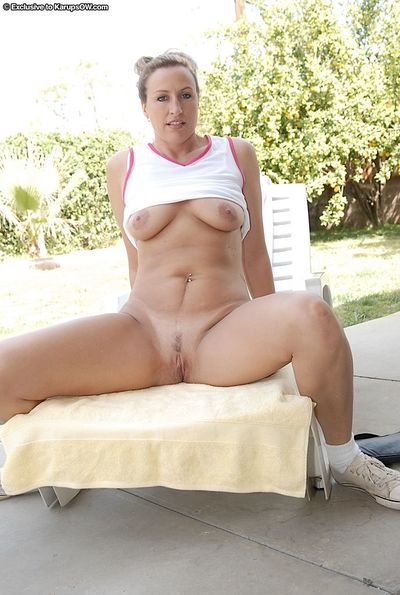 Naughty mature lady in sport outfit undressing and teasing her gash outdoor