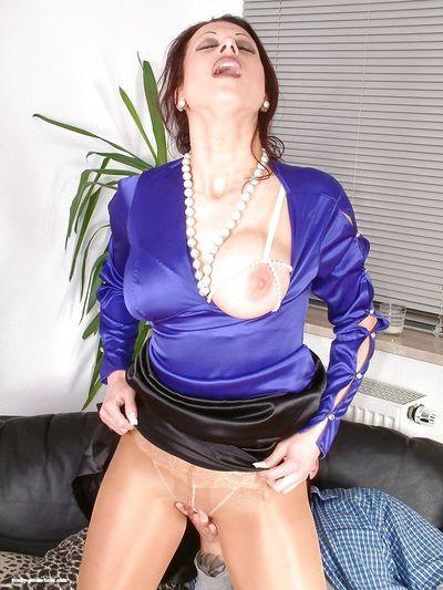 Smoking mature babe in pantyhose gives a blowjob and rides a hard cock