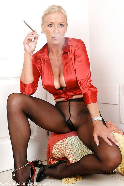 Mature fetish lady in pantyhose smoking and revealing her massive tits