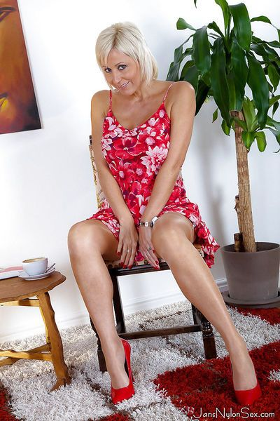 Stupendous mature blonde in nylons revealing her big bosoms and inviting slit