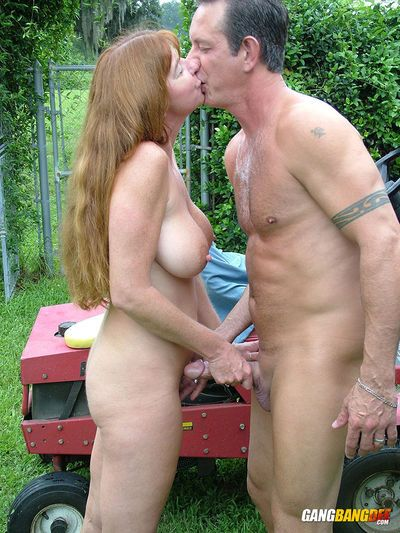 Older amateur Dee Delmar hops on her guys dick while he mows the lawn