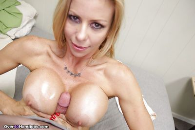 Busty mature blonde giving titjob and handjob for cumshot on tits