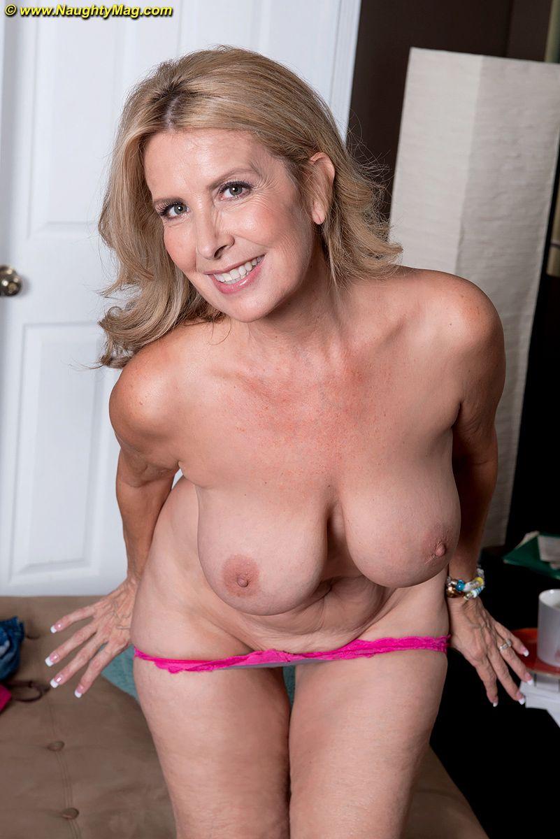Hot mature amateur Laura Layne loses jeans & thong panties & bares big tits