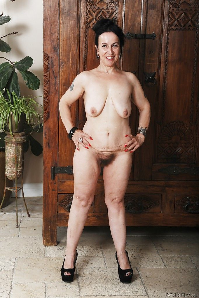 Mature Miss Nina Swiss shows off her hairy snatch and saggy tits