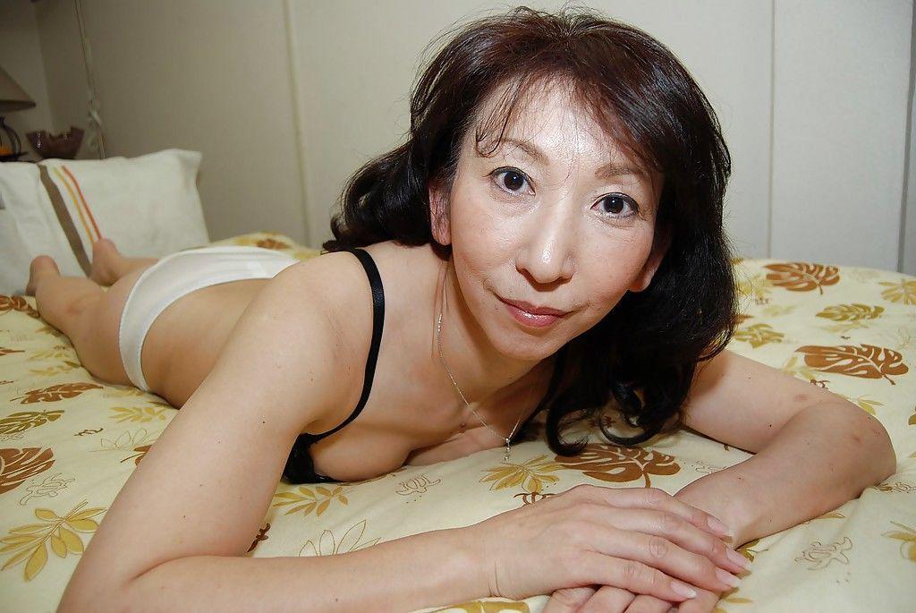 Asian housewife Mako Shinozuka takes a hot shower while all alone