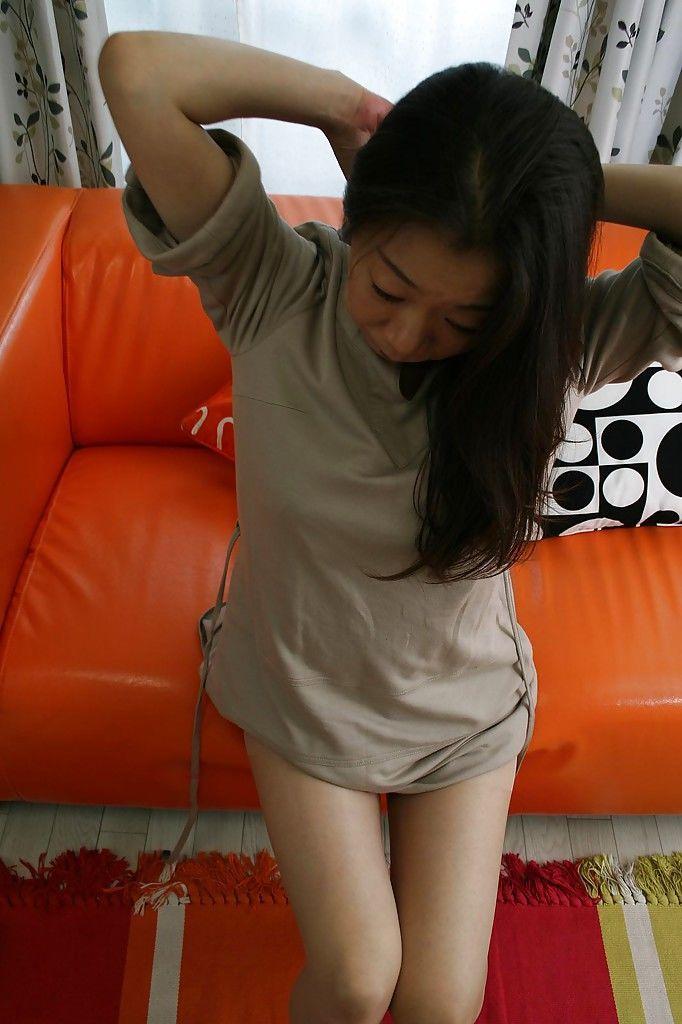 Asian mature brunette Yoshiko Makihara is showing off in sexy pantyhose