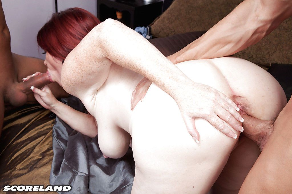 Plump older woman Heather Barron having sex with 2 men at same time