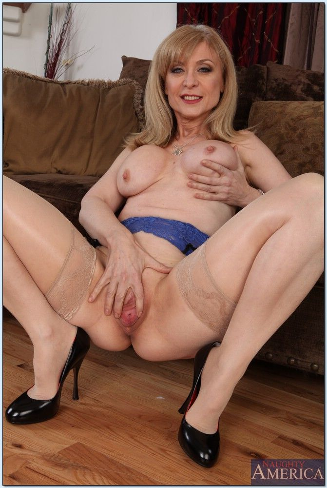 Seductive mature lady Nina Hartley slipping off her dress and lingerie