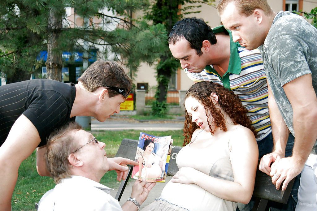 Curly-haired pregnant slut gets banged by four horny lads outdoor