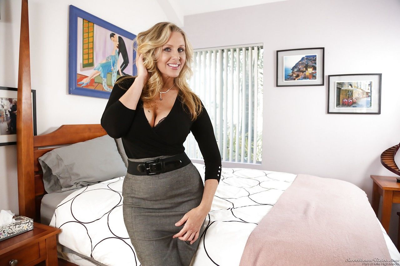 Mature blonde MILF in skirt removes lacy lingerie to flaunt big boobs