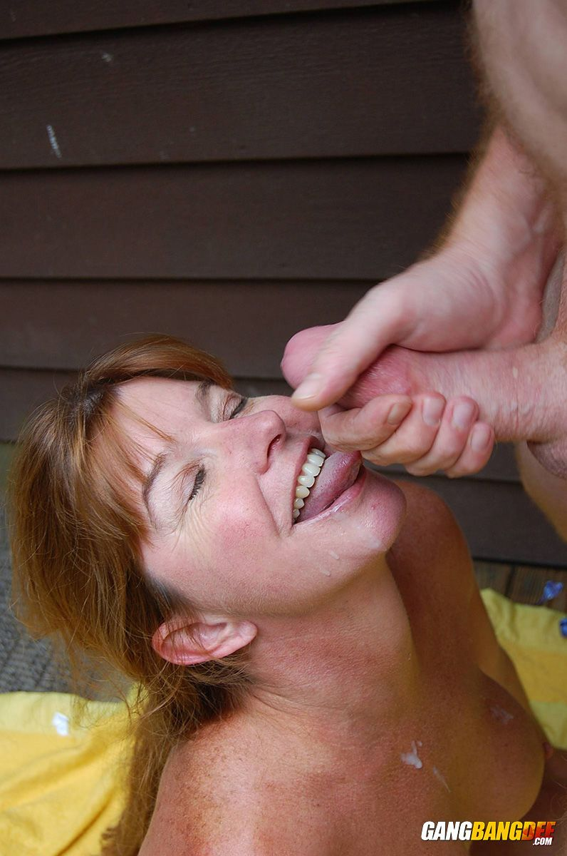 Older redhead amateur Dee Delmar bangs one guy then another behind her house
