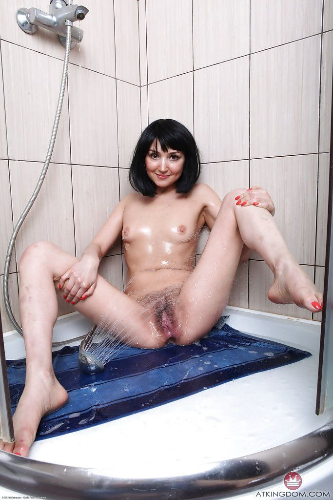 Matilda enjoys rubbing the pussy in the shower while home alone
