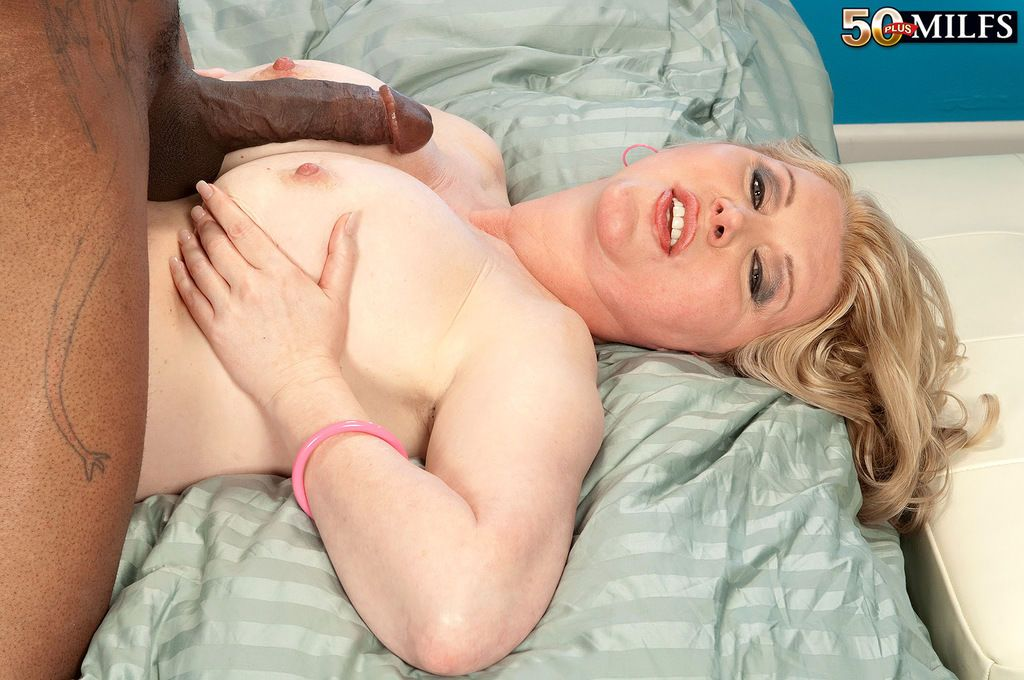 Sultry mature with a curvy body and fair hair gets impaled on a big black dick