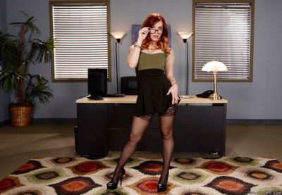 Glasses adorned solo girl Dani Jensen exposing big tits and ass in office