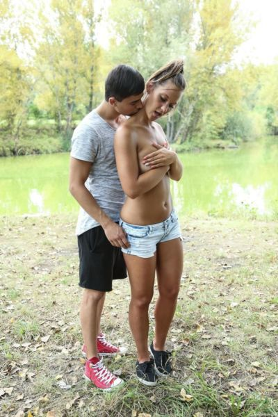 Euro girl with high ponytail and her boyfriend fuck on blanket by river