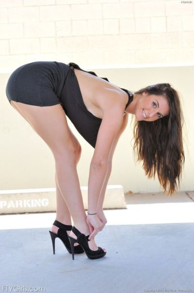 Clothed babe in high heels spreading for sexy upskirt in public