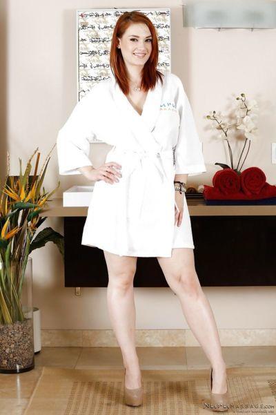 Redhead leggy mademoiselle Siri takes off her panties in the bathroom
