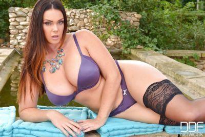 Stocking garbed plumper Alyson Tyler unleashing huge boobs outdoors