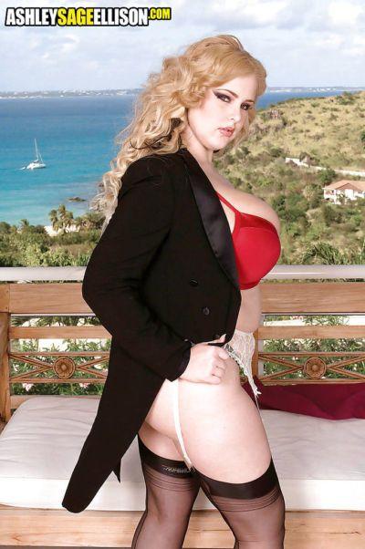 Blond plumper Ashley Sage Ellison frees massive pornstar tits from lingerie