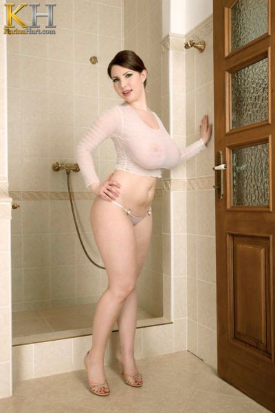 Thick solo model Karina Hart wets her knockers under shower spray