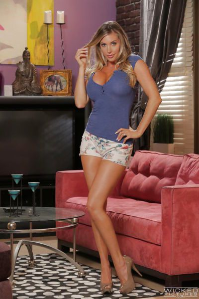 Stunning blonde Samantha Saint poses clothed and masturbates