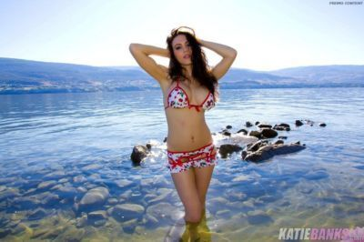 Amateur solo girl Katie Banks peels off micro skirt and bikini in the ocean