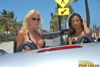Hot chicks in bathing suits turn lesbians on top of a sports car