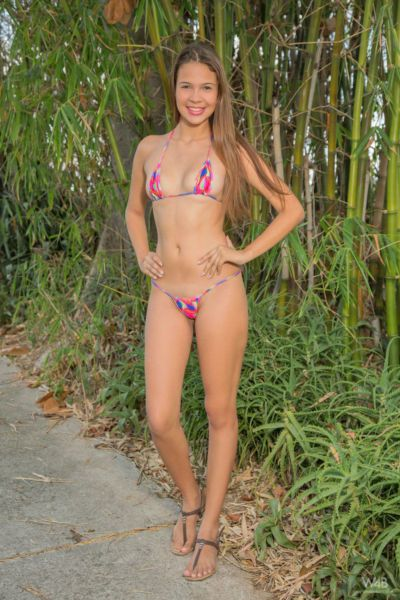 Sweet little Kiara Lorens happily shows off her teen pussy in the woods