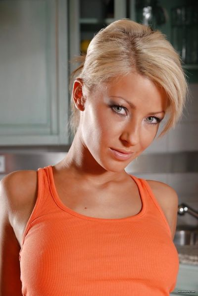 Sexy blonde chick Thea stuffing sex toys in her wet pussy on kitchen counter