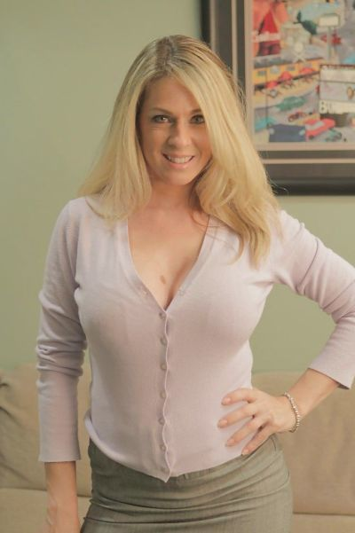 Blonde milf Angela Attison is undressing her blue panties and bra