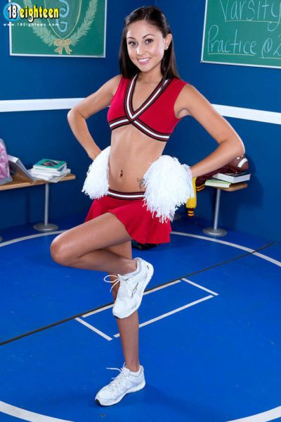 18 year old cheerleader Ariana Marie strips off her uniform to pose for nudes