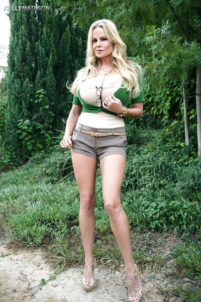 Big tits lady Kelly Madison is demonstrating her body outdoor
