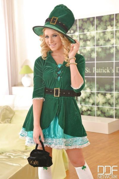 Blonde slut Kiara Lord spreading her pussy in a green leprechaun suit